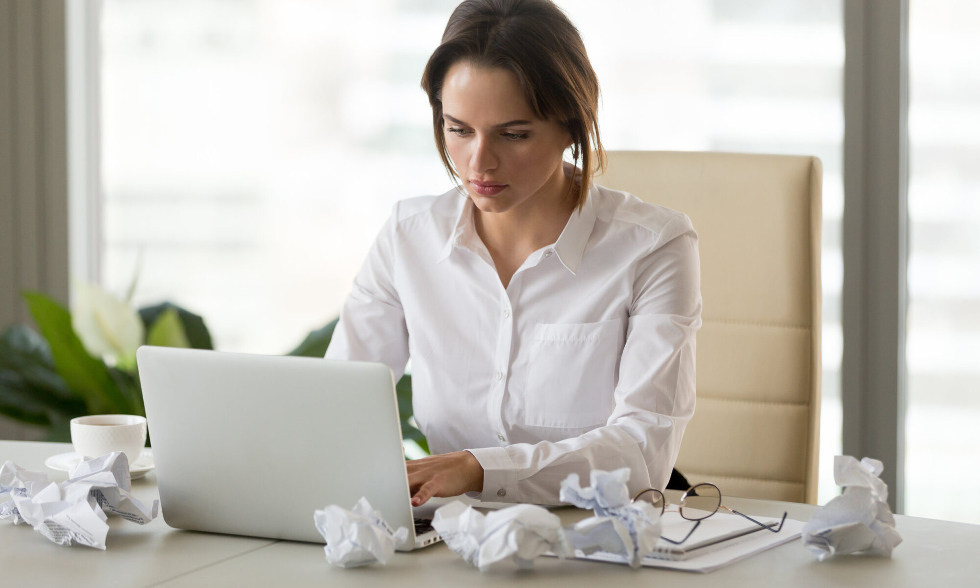 Upset businesswoman feel unmotivated trying to apply for jobs
